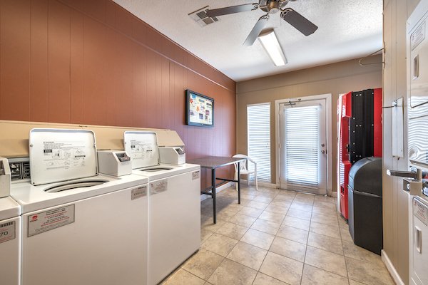 Laundry room at Lincoln Monarch Medical Center Apartments in Houston